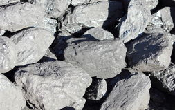 Stack of large and black coal lumps prepared for winter. In sunny day Stock Photography