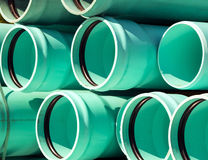 Stack of large sewage pipes Royalty Free Stock Photos