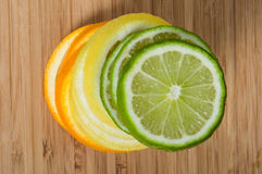 Stack of lemon, lime orange. Stack of lemon, lime and orange slices stock photography