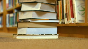 A stack of library books stock footage
