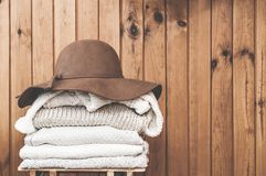 Stack of light sweaters and a hat royalty free stock image