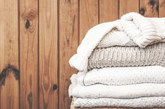 Stack of light sweaters royalty free stock images