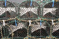 Stack of lobster traps or lobster cages. At port Stock Images
