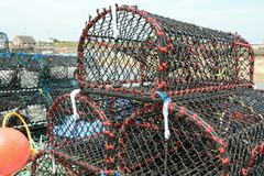 Stack of lobster traps or lobster cages. On quay Stock Photography