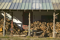Stack of logs in front of cabin in Mescalero Apache Indian Reservation near Ruidoso and Alto, New Mexico Stock Images