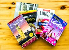 London travel books on a table. Stack of 5 London travel guides on a wooden table stock photos