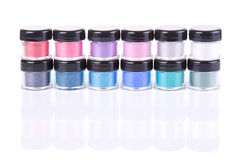 Stack of loose eye shadows in plastic jars Stock Photography