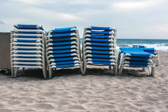 Stack of loungers on the beach Royalty Free Stock Photos