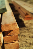 Stack of lumber. At construction site stock image
