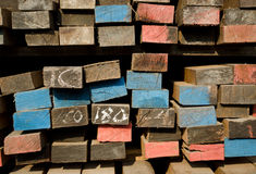 Stack of lumber in timber logs storage. With colour on the wood Stock Photography