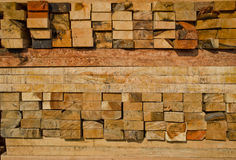 Stack of lumber in timber logs storage. Lumber stocking ready for sale in thailand Royalty Free Stock Photography