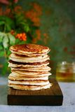 A stack of lush punkcakes for breakfast on a gray background. High pile of delicious pancakes with berries.American Cuisine Stock Image
