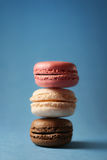 Stack of Macarons. Closeup of stack of different colored macarons, against a light blue background Royalty Free Stock Photo