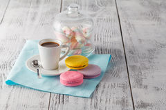 Stack of macaroons and espresso coffee. On rustic wooden background Stock Photography