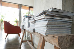 Stack of magazine book on wooden table shelf Royalty Free Stock Photography