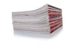 The stack of magazine isolated on the white background Stock Image