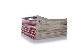 The stack of magazine isolated on the white background Stock Photography