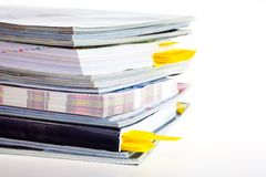 A stack of magazines. Closeup background of a pile of old magazines Royalty Free Stock Photos