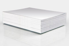 Stack of magazines with a blank cover. Isolated on white Royalty Free Stock Image