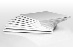 Stack of magazines with a blank cover. Isolated on white Stock Photography