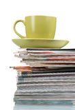 Stack of magazines and cup Royalty Free Stock Photos