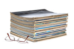 Stack of magazines with reading glasses Stock Photography
