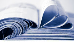 Stack of magazines toned blue isolated Royalty Free Stock Photos