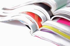 Stack of magazines on white background Royalty Free Stock Photo