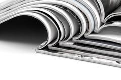 Stack of magazines on white background Stock Image