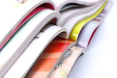 Stack of magazines on white background Stock Photo