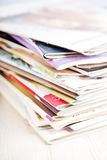 Stack of magazines on white table Royalty Free Stock Photos