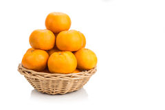 Stack of mandarin oranges in basket with white background Royalty Free Stock Photos