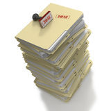 Stack of manila office folders or files on white b. Many manila files or folders stacked and rubber stamped with year 2012 stock illustration