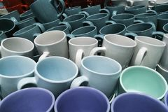 Stack of many colorful emty ceramic cups closeup. Stack of many colorful emty ceramic cups royalty free stock photos