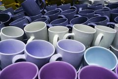 Stack of many colorful emty ceramic cups closeup. Stack of many colorful emty ceramic cups royalty free stock photography