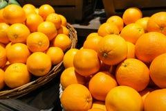 Stack of many fresh mandarin oranges in the market. Royalty Free Stock Image