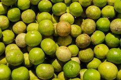 Stack of many green lime in the market. For food, fruit, kitchen, texture, background and vegetables royalty free stock photography