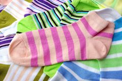 Stack Of Many Pairs Colorful Striped Socks Isolated On White. Stack Of Many Pairs of Colorful Striped Socks isolated On White Background Stock Images
