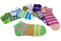Stack Of Many Pairs Colorful Striped Socks Isolated On White. Stack Of Many Pairs of Colorful Striped Socks isolated On White Background Royalty Free Stock Images