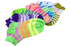 Stack Of Many Pairs Colorful Striped Socks Isolated On White. Stack Of Many Pairs of Colorful Striped Socks isolated On White Background Royalty Free Stock Photos
