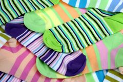 Stack Of Many Pairs Colorful Striped Socks Isolated On White Stock Photos