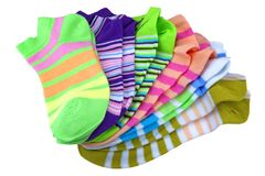 Stack Of Many Pairs Colorful Striped Socks Isolated On White. Stack Of Many Pairs of Colorful Striped Socks isolated On White Background Stock Photos