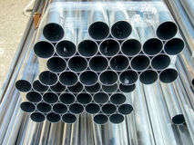 Stack of Many Pipes at the Construction Site Stock Image