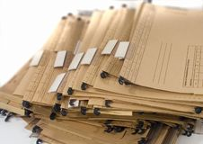 Stack of marked paper documents with plastic clips royalty free stock photos
