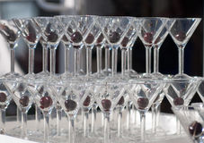 Stack of martini glasses. Stack of  empty martini glasses with cherry inside each glass Royalty Free Stock Photography