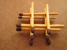 A Stack of Matches. Match sticks arranged in a square like stack on a brown surface stock photos