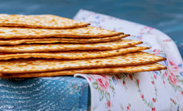 Stack of matzah or matza on a vintage wood background with copy space. Stock Image