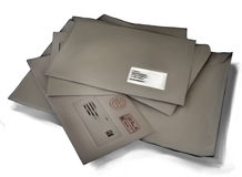 Stack of messy closed brown paper mail envelopes Stock Photos