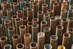 Stack of metal pipes for scaffolding. With traces of rust stock photos