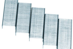 Stack of metal staples. Isolated on a white. Stock Image